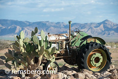 An antique tractor is left behind in the small town of Solitaire, Namibia, just outside of the Namib desert. (Remsberg Photos) Tags: africa namibia solitaire namib desert tractor equipment abandoned rust heat dry landscape mountains antique antiquated nam