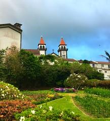 hidden church (ekelly80) Tags: azores portugal sãomiguel may2017 furnas church steeple hidden grounds green flowers sky