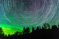 Star Trails with Aurora Borealis (-> LorenzMao <-) Tags: httpwwwlorenzmaophotographycom startrailswithaurora startrails star lighttrails nikond7000 nightphotography nikon d7000 sigma1750mm northernlights auroraborealis arundel quebeccanada canada clouds color greencolor trees hill