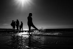 water games (Georgie Pauwels) Tags: beach water fujifilm public sea streetphotography blackandwhite candid
