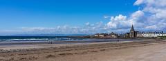 Ardrossan beach (Rourkeor) Tags: ardrossan ayrshire scotland unitedkingdom gb beach sand water sea waves bright clouds people church sony sonyrx1r rx1r carlzeiss zeiss fullframe sonnar t 35mm
