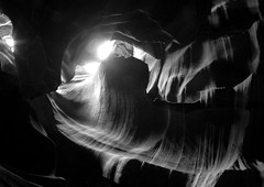abstract / light (travelben) Tags: antelope canyon national park usa page america bw nb navajo arizona blackwhite abstract black background surreal photo border tunnel speleo boyau caving southwest desert colors delicate cave wanderlust explore perception adventure sandstone slot eroded soft light landscape nature rock tumbleweed thistle wedged caught stuck erosion dry