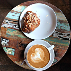 Coffee and a croissant at Storyville Coffee (Ruth and Dave) Tags: storyvillecoffee pikeplace seattle coffeeshop cafe table stool coffee latte latteart croissant almondcroissant treat pastry