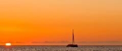 Setting Sail (brev99) Tags: sunset sigma1770os d90 hawaii waikiki oahu sailboat sun