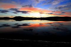 Reflect on the day (alan.irons) Tags: reflections landscape sunlight sunset clouds lintrathen loch scotland scottishwater lake water dusk reds orange bluesky still calm tranquil flat hills