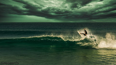 Air time - DSC05881-15 (cleansurf2) Tags: sony surreal sunset storm surf surfer sunrise seascape surfing green dark waterscape waves water wide wave dawn ocean ilce tones resolution emount 3840 widescreen wallpaper aqua screensaver hires landscape mirrorless newcastle black background backdrop beach vivid coast color colour clouds cloud