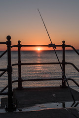 DSF_2088.jpg (alfiow) Tags: fishingrod railings sunset totland