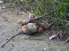 Abandoned toy (Nikos Karatolos) Tags: abandoned toy rubish thrown away samyang 50mm f12 field garbage