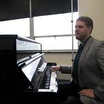 Dr. Perttu playing piano.