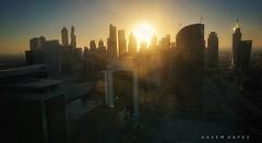 Dubai Skyline ... (Hazem Hafez) Tags: city cityview skyline dubai sun sunset towers downtown cosmopolitan sky skyscrapers