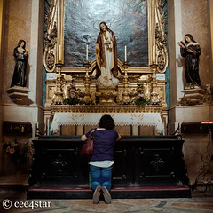 Kneeling at the alter (cee4star) Tags: alter 1855 lisbon church people fujifilm portugal religion mural praying candid travel shrine woman altar xpro2 kneeling colour europe faith xf