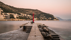 Bay Watch (McQuaide Photography) Tags: dubrovnik croatia hrvatska dalmatia ragusa europe sony a7rii ilce7rm2 alpha mirrorless 1635mm sonyzeiss zeiss variotessar fullframe mcquaidephotography adobe photoshop lightroom tripod longexposure travel water bay sea adriatic harbour harbor port oldport oldportofdubrovnik staraluka 169 widescreen oldcityharbour ndfilter neutraldensity nd bwfilters pier golden calm tranquil peaceful serene jetty stonejetty viewpoint coast sunset
