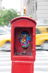 Face in a Box (Andrew Aliferis) Tags: nyc newyorkcity aga andrew andy aliferis fire box mask face painted colorful taxis slow shutter blur nikon 300d 14thstreet manhattan