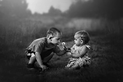 Kindness (Kapuschinsky) Tags: blackandwhite bnw monochrome bnwfineart fineart fineartphotography fineartportrait portrait portraiture childportrait baby candid children babies family cousins sharing kindness love emotive moody outdoors outside field path pathway naturallight sonyalpha sonya700 minolta pennsylvania pennsylvaniaphotographer sonyphotographing lifestyle documentary nature