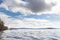 Sunny spring day in Altafjord (johansenfoto) Tags: alta russeluft finnmark norway norge noreg altafjord altafjorden arctic europe europa landscape clouds sunny blue sky pinetree boathouse båthus båt hus tre naust sea ocean outdoor tamron 2470