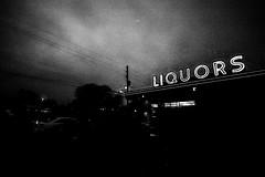 DSC_8246 (G. L. Brown) Tags: liquorstore night snow nashville nashvillestreetphotography streetphotography noir blackandwhite bw america tennessee