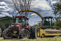 First Crop (Szoki Adams) Tags: vermont farmers tractors johndeere hay clouds umbilicalcord weather bigwheels treads grass turning trees springtime outdoors