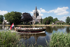 Boat @ Nes a/d Amstel (PaulHoo) Tags: holland netherlands nes aan de amstel river reflection church architecture building boat recreation 2017 fujifilm fuji x70 sky landscape nature