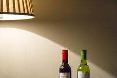 Enjoy ... (Jan van der Wolf) Tags: map169288v lamp light shadow shadowplay schaduw wine wijn bottles enjoy composition compositie redwine white red whitewine wall muur indoor genieten redandwhite redandwhitewine