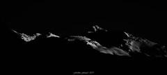 Lueurs de Cimes 2/2 (Frédéric Fossard) Tags: noiretblanc lumière ombre contraste fondnoir paysage montagne cimes neige alpes vanoise savoie tarentaise clairobscur crête arête abstrait surréaliste sombre dramatique lueur glacier montbréquin blackandwhite silhouette black blackwhitepassionaward