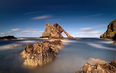 Bow-Fiddle (ShinyPhotoScotland) Tags: amazement art awe beautiful blur bowfiddlerock brightsunlight circularpolariser clouds coast colour composition conglomerate darktable dcraw digikam digitalgradnd digitallowpass digitalred dramatic dynamic elegance flowing geology goldenhour gradnd25 hardsoft horizon idyll imposing landscape landwater lightanddark longexposure moment moray motionblur motionstationary nature nd1000 nearmidfardistance northsea pentaxk1 pixelshift portknockie pure quartzite raw rockstone rockwater rugged rules samyang24mmf14 sandstone saturated scotland sea shapeandform shapely skyearth striking sumptuous sunlight timefulness toned transience turbulence uplifting vintage vista water zen