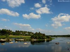 Largesse at large. (mohulbhowmick) Tags: canon 1300d 18mm mysore srirangapatnam karnataka india indiatraveldiaries indiapictures instagram karnatakatourism karnatakapictures sky clouds river blue trees green lush bushes