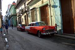 Streetcar named desire, Havana (againandagain251) Tags: centrohavana cuba classiccar redclassicford walkonby colourfulbuildings bigdoors balconies shinycar streetlife onewaystreet