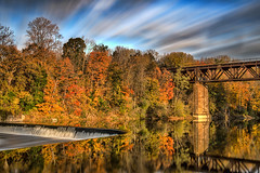 A sunrise photo from last fall at Paris Dam (angie_1964) Tags: paris dam sunrise clouds reflections water train bridge ontario canada morning nature trees fall autumn nikond800e longexposure