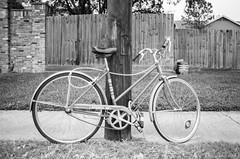 00140019 (alexdotbarber) Tags: 12800 35mm contaxaria houstonfourthward ilforddelta400 slr yashicayusautomatic28mmf28 analog bicycle blackandwhite blackandwhitefilm f28 manualfocus monochrome