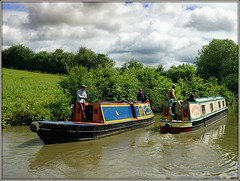 Narrowboats passing. (Jason 87030) Tags: pleasure leisure boats canal grandunioncaal event historic rally craft vessel color colouc sky weather june 2017 mean people scene view northants northamptonshire water cut refelction clouds britishwaterways crt 7 sony tardebigge