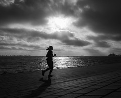 movement (Georgie Pauwels) Tags: movement jogger jogging woman run running sea clouds streetphotography candid olympus water seaside