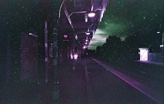 The hulk came on the night train (von8itchfisk) Tags: lomography purple film 35mm olympus om10 needham market suffolk east anglia train station vonbitchfisk night