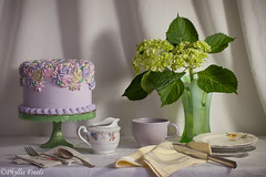 Still life green hydrangeas. (Phyllis Freels) Tags: phyllisfreels cake cakestand creamer cup flowers green hydrangea indoor lilac plates silver stilllife tablecloth tabletop vase vintage white yellow