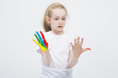 Kids Concepts. Portrait of Surprised Young Girl Looking At Messy Colorful Hands Brightly Painted During Paint Craft. Against White Background. (DmitryMorgan) Tags: 1 711years active againstwhite artist artistic arty caucasian cheerful child childhood color colorful colour concept craft creative creativity daughter drawing education female fingers fun gouache hand happy kid little messy multicolor one paint painter palms people playful pleasure positive preschooler smiling tshirt young