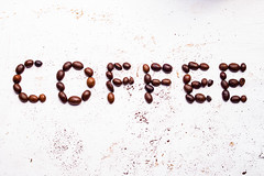 The word coffee from coffee beans (wuestenigel) Tags: wood word natural breakfast table brown background hot morning food decoration style fresh cup group espresso aroma vintage gourmet black texture hipster written drink closeup space roasted grain dark aromatic old caffeine alphabet arabic beans coffee isolated