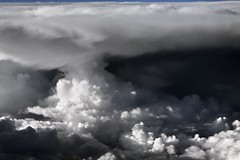 Clouds: Open Into a Gale (idintify media) Tags: idintifymedia photography image art fineart nashville blackandwhite color digital canon 50d eos film banner desktop stock free mystery suspense fiction magic haunting supernatural blue white cloud sky storm airplane air thunder rain lightning day bright space outerspace valley landscape contrast natural nature photographer dslr pro professional shadows light culture community