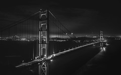 B&W Gate (Ash and Debris) Tags: nightlights night usa blackandwhite high water city bridge goldengatebridge traffic clouds lights california bw urban road monochrome architecture tower construction nightcity sky sanfrancisco goldengate light unitedstates