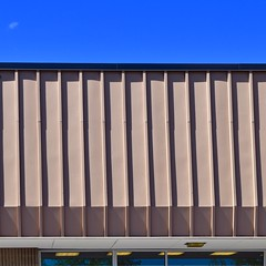 Urban Abstract No 48 (llawsonellis) Tags: urban abstract crop selection urbanabstract architecture siding windows reflections metal blue sky building modern line lines linear design patterns square squareformat nikon nikond5300 shadows rhythms abstractures fragment yellow beige roof minimal