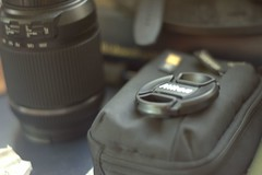 Photoarrangement (navarrodave80) Tags: lens glass desk cap camerabag