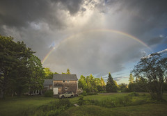 This rainbow view was worth getting rained on some while mowing the yard :) - Tenants Harbor Maine (Jonmikel & Kat-YSNP) Tags: rainbow storm rain sky afternoon maine tenantsharbor me stgeorge oldwoodsfarm summer farmhouse barn field grass
