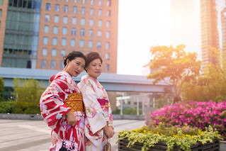 Mother and daughter in Kimono together in city