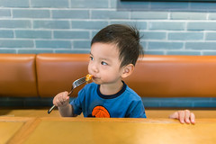 Portrait of baby boy eating food with fork (HIKARU Pan) Tags: 1dx 23years 24l abundance asia canon canonef24mmf14lii china eos1dx portrait shanghai babyboy babyclothing beautiful blackeye blackhair carefree casualclothing cheerful child childhood chineseethnicity concentration curiosity cute discovery domesticlife eating emotion enjoyment exploration food fork frontview fun happiness headshot healthyeating holding horizontal indoors innocence joy lifestyles partof person photography playful positiveemotion simpleliving sitting
