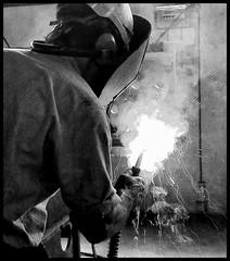 Ironman (marcobertarelli) Tags: ironman iron welder weld factory work hard bw lights shadows smoke flash monochrome monochromatic industrial photography man worker