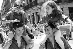 Castell Celebrations in Barcelona (Geraint Rowland Photography) Tags: festival children candid streetportraits party celebration celebrate catalonia santjaumesquare barcelona spain blackandwhiteartisticphotography 50mm14 geraintrowlandphotography geraintrowlandinbarcelona catalantradition piggyback happy excited naturalphotography streetphotographytoursinbarcelonabygeraintrowland wwwgeraintrowlandcouk kids travel documentaryphotography canon liveforthestory canonespaña life lifeonthestreets
