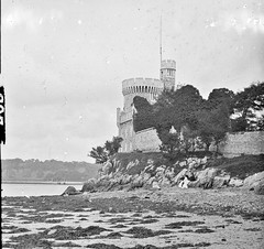 """Unidentified castle on seashore"" is Blackrock Castle (National Library of Ireland on The Commons) Tags: thestereopairsphotographcollection lawrencecollection stereographicnegatives jamessimonton frederickhollandmares johnfortunelawrence williammervynlawrence nationallibraryofireland castle river sea estuary trees seaweed cork blackrock blackrockcastle riverlee corkharbour picnic shoreline lowtide locationidentified"