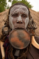 Big Lip Plate, Mursi Tribe (Rod Waddington) Tags: africa african afrique afrika äthiopien ethiopia ethiopian ethnic etiopia ethnicity ethiopie etiopian omo omovalley outdoor outdoors omoriver mursi tribe traditional tribal lipplate portrait painted face female woman hut village camp
