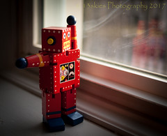 I Am IN Here (HWW) (13skies) Tags: hww robot toy wooden windowlight windowwednesday sunlight