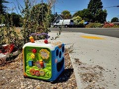 Done Playing (RZ68) Tags: toy childs box colorful lost abandoned discarded plaything thing bright street roadside sidewalk lg g6 camera phone smartphone road down low baby toddler infant thrown away left garbage trash junk learning cars