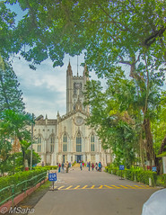 St. Paul's Cathedral (MrSaha) Tags: st pauls cathedral kolkata building architecture urban urbanite cityscape desert downtown landmark town busy tree leaves branches plants flower root grass hay way blue sky cloud clouds day sun sunny nikon d52000 dslr panaromic tall wide nature landscape manual earth top bright dim shadow light around view look travel happy life lively adventure globe world lonely peace peaceful calm quiet moment sharp clear soft beautiful capture red green color colors vivid vibrant legend