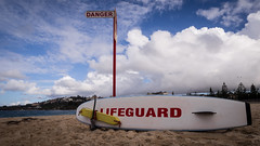 Lifeguard (Mariasme) Tags: sign beach coogee clouds surfboard